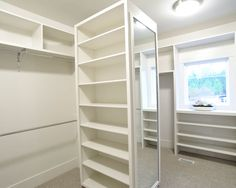 Why waste the middle of a walk in with a bench or short dresser (that I'm sure to leave a mess).  Traditional Closet Master Bedroom Closet Design, Pictures, Remodel, Decor and Ideas - page 19