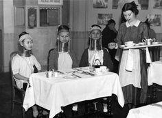 Burmese 'Giraffe-necked' women having tea in England, c. 1935.