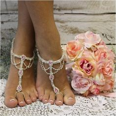 Something special and pink for your beach wedding. Our popular silver and pink rhinestone foot jewelry are stunning for your dream beach wedding. Tradition inspired these stunning rhinestone barefoot