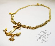Large Gold Anchor Necklace With Various Chains, A Tiny Star And A Tiny Skull Charm
