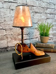 Incredible vintage shoe last. This little bit of history was just too interesting to leave in a dusty old box. We have thoroughly cleaned and sealed this relic, mounted it to a reclaimed wood base and added a new UL approved candelabra base socket, a rotary dimmer switch, a wonder