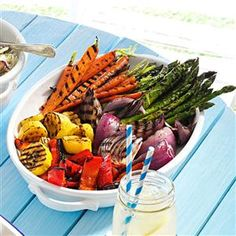 Grilled Vegetable Platter Recipe -The best of summer in one dish! These pretty veggies are meant for entertaining. Grilling brings out their natural sweetness, and the easy marinade really kicks up the flavor. —Heidi Hall, North St. Paul, Minnesota