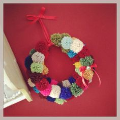 Huge wool pom pom wreath multi coloured  on Etsy, £35.00