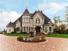 I want a house with stone and a turret...too much to ask for? :) ... Oh and mountains in the back! :)