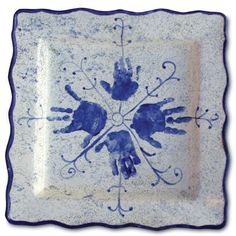 Blue handprint snowflake platter. maybe a paint your own pottery place?