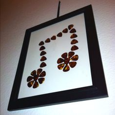 Made this for my brother in law because he loves to play the guitar. Bought a frame and guitar picks. Glued them in a shape of a music note. Easy gift idea!!