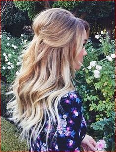 Half up half down hair with some volume and beachy waves