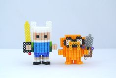 "Adventure Time Finn and Jake 3D Perler figures  Mathematical! These 3"" and 3.5"" tall 3D Perler Finn and Jake figures both come with removable swords. Handmade to order, these guys are ready to kick some ice king butt.   There are separate listings for the individual figures  Finn https://www.etsy.com/listing/192362816/adventure-time-finn-3d-perler-figure?ref=related-1  Jake https://www.etsy.com/listing/192363378/adventure-time-jake-3d-perler-figure?ref=related-2"
