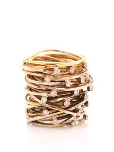 pintaldi maurizio messy stacked gold rings with white stones, what an impact