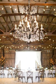 This large crystal chandelier, with a black metal body, was a perfect fit for The Barn at Little Herb House in Raleigh, NC.  Planner: Redbird Events.  Chandelier by Get Lit, Special Event Lighting.
