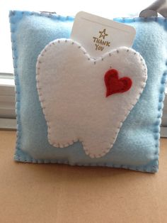 Tooth Fairy Pillow and 20 Notes, Light Blue Pillow with Heart http://www.ismiledentists.com/