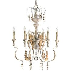 The Marion chandelier is inspired by the antique rural reproductions of centuries- old aristocratic European design.  Featuring imperfectly formed scrolling arms, wood accented bobeches and finials, this endearing creation pays homage to Baroque styling but in the primitive manner found in the rural European Farmhouses of centuries past
