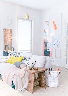 LOVE this bright and airy space with colorful accents!