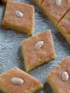 Namoura (نمورة) is a delicious Middle Eastern Cake made with semolina flour, topped with almonds and soaked with a traditional aromatic sugar syrup. Arabic Dessert, Arabic Sweets, Arabic Food, Lebanese Desserts, Lebanese Recipes, Indian Dessert Recipes, Sweets Recipes, Dessert Ideas, Recipes