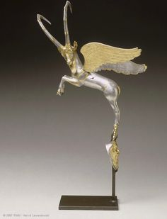 Sumptuous silver and gold leaping winged ibex. A vessel handle from the Palace of Darius I, Susa,