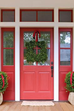 Decorated Door - Coastal Christmas Home - Southernliving. The home's front door, conveniently painted red, lends itself to holiday dressing.