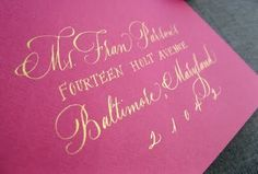 Gold calligraphy on magenta paper