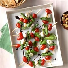 Caprese Salad Kabobs Recipe -Trade in the usual veggie party platter for these fun kabobs. I often make it for my family to snack on, and it's a great recipe for the kids to help with. —Christine Mitchell, Glendora, California