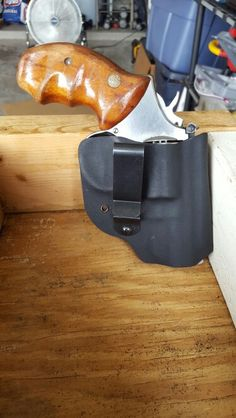 Kydex holster for a revolver.