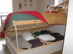 This fantastic Smart Under-bed Storage DIY project is a hack of the Ikea Dalselv Bed Frame. The maker cut off the legs of the basic bed frame, built a box and attached the bed frame overtop it with hinges. And voila, a cost effective custom solution that provides tons of long-term storage, right at your fingertips! Photo credit: ikeahacker.blogspot.com.