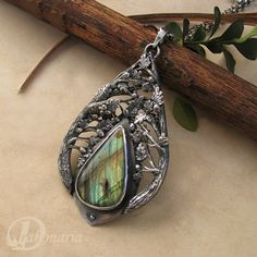 """Oak Wisdom"" by Anna Mazon of Drakonaria. Beautiful oak leaf themed pendant. Hand carved, oxidized silver and a beautiful labradorite."