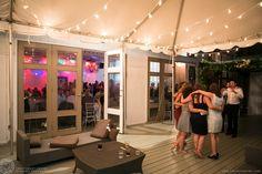 Guests enjoying the patio lights.  Berkeley Fieldhouse Wedding, Toronto Wedding Photographer. #sweetheartempirephotography