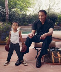 "150shadesofblack: "" home-of-hip-hop: "" old-school-shit: "" zizidur: "" Muhammad Ali and his grandson "" This is actually such a beautiful photo "" shit looks like him "" rip """