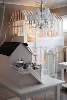 2 story doll house w/veranda and stairs...2 story bunk beds in dollhouse design.