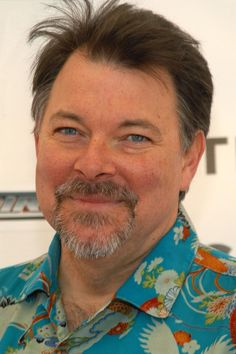 Commander William Riker. Handsome, dark-haired, blue-eyed actor/director Jonathan Frakes is best known among Star Trek lovers for playing Commander William Riker in Star Trek: The Next Generation (1987-1994).