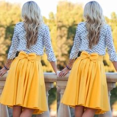 "Yellow Bow Skirt Lightweight silky material pleated skirt. Brand-new, never worn. Looks great with a polkadot top and a petticoat worn underneath. Can wear it with the bow facing front or in the back.            Measurements: Length from waist to hem: 26"", waist circumference: 30"". Skirts Midi"