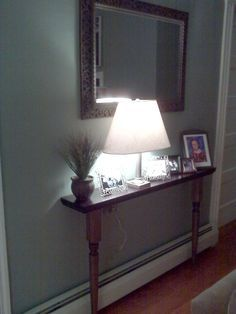 possible to make this over the hallway radiator... four spindles, a long narrow piece of wood for the top, and paint it white.