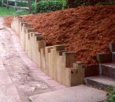 If your garden is on any kind of a slope, it's possible a garden retaining wall might make your property more usable, and more valuable. Retaining walls hold back soil to allow a level planting. Diy Garden Bed, Garden Edging, Garden Borders, Garden Planters, Lawn And Garden, Container Garden, Easy Garden, Edible Garden, Garden Retaining Wall