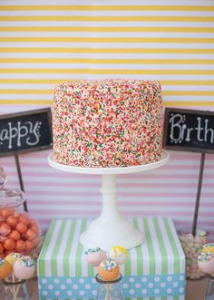 Cake covered in sprinkles! Colorful Tutti Fruitty Party with Lots of REALLY CUTE IDEAS via Kara's Party Ideas | KarasPartyIdeas.com #TuittiFruittyParty #TweenParty #Paryideas #sprinklecake