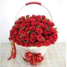 Get 100 Red Rose Round White packing Handle basket red ribbon at Rs.2,799.