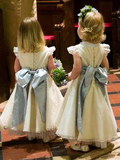 Custom dress with BIG blue bows. | Nicki Macfarlane.  Love the matching flower headband