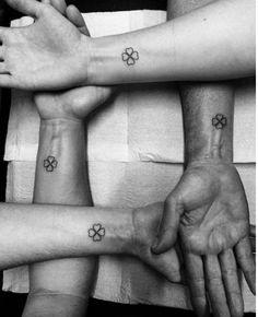 Matching clover tattoos by Tiago Oliveira