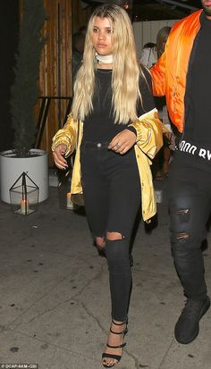 Relaxed style: Sofia Richie dressed down in black and gold for a rendezvous at her favorit...
