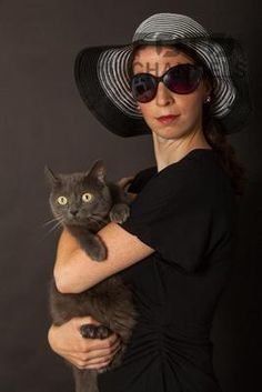 woman in black with cat