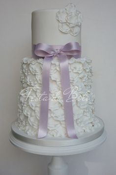 wedding cake-- I would use a different color bow...maybe burlap with pearls and a pink rose on the top...