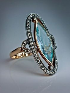 Antique Jewelry An Edwardian Era Antique Aquamarine and Diamond Long Ring circa 1910 The ring features a navette (marquise) cut aquamarine (approximately carats - 19 x x mm), set in a yellow gold bezel within an oval rose cut diamond frame. The shoulde Jewelry Box, Jewelry Rings, Jewelry Accessories, Fine Jewelry, Jewelry Design, Jewelry Sketch, Jewelry Clasps, Jewelry Armoire, Jewelry Supplies