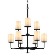 The Rustic Huntely chandelier in Oil Rubbed Bronze. Ivory Powder Frit glass shades give the warm feeling of burning candles. This would look amazing in the entryway.
