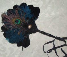 Peacock feather fan.