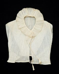 Ever wonder what a chemisette looks like? They come in many shapes, but all serve the same purpose: Filling in open necklines of Regency-era gowns. This one is made of white cambric and is dated between 1800-1825.