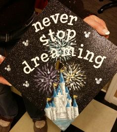 My Purdue graduation cap! I got accepted into the Disney college program for this spring, so in honor of going, I painted Cinderella ' s castle with fireworks.