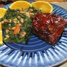 Baked BBQ Baby Back Ribs Recipe.  Yum!  I made these for dinner tonight, and the meat was literally falling off the bone--so tender!