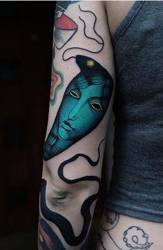 Aleksy Marcinow snake tattoo