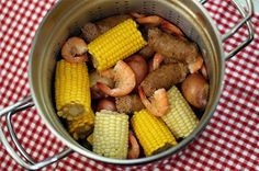 Cajun Shrimp Boil - Learn how to do a do a Louisiana-style boil with extra-large shrimp, sweet Andouille sausage, fresh corn and new potatoes.