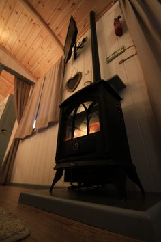 Snuggle up by the fire in Grand Shepherd Hut Sands at Three Cliffs Bay Holiday Park, Gower