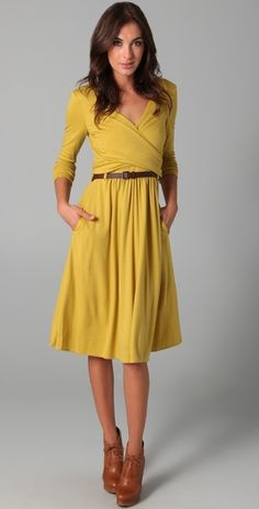 This yellow dress would be good for less formal presentations or work days. The hemline & neckline keep this dress work appropriate and professional, but the three quarter sleeves & wrapped waistline make this dress pretty and fun. For more formal situations, pair with a classic black or chocolate blazer and a traditional heel style.