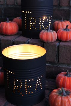 For an easy and affordable way to decorate your home this Halloween, make luminaries using paint, candles, and empty tin cans. Get the tutorial at Jolly Mom.